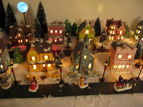 an aerial view of my little christmas village my mom did an awesome job painting these they are very cute and very detailed